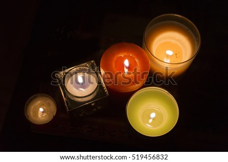 Varied candles lit