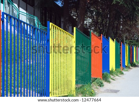 Variegated metal fence - stock photo