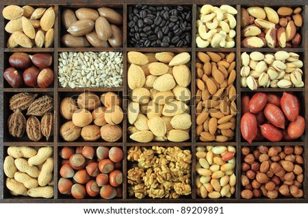 Varieties of nuts and other seeds: peanuts, hazelnuts, chestnuts, walnuts, cashews, pistachio, almonds, coffee, sunflower seeds and pecans. Food and cuisine.