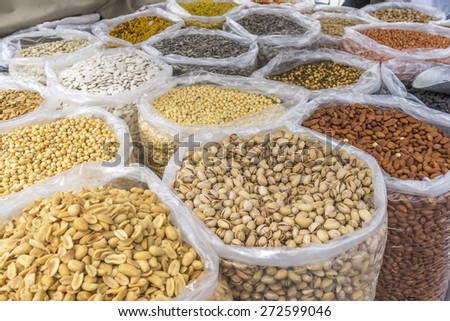Varieties of nuts: peanuts, hazelnuts, chestnuts, walnuts, pistachio and pecans. Food and cuisine.  - stock photo