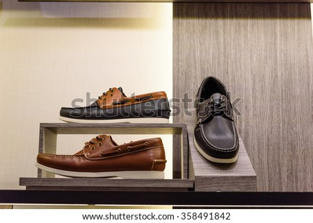 Variety leather casual derby shoes on the shelf in the menâ??s fashion footwear and accessories shop in Singapore. Casual, fashion and work shoes for men. - stock photo