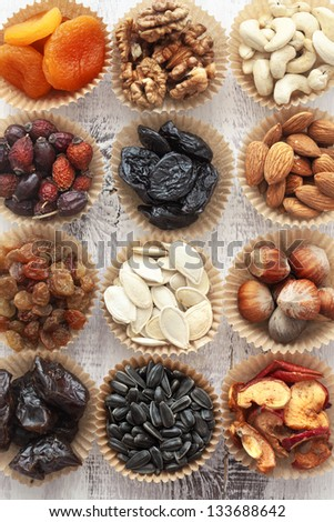 Variety of 12 assorted nuts and dried fruits - stock photo