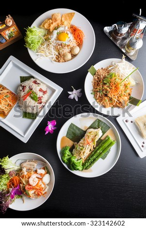 Variety of authentic Thai cuisine and stir fry dishes.  Shallow depth of field. - stock photo