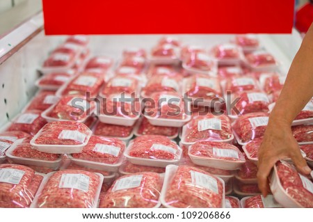 Variety of beef forcemeat in boxes in supermarket - stock photo