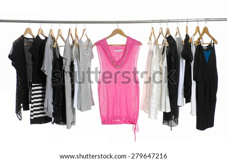 Variety of casual female sundress clothes hanging