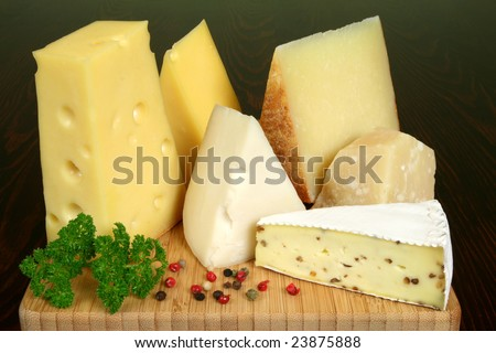 Variety of cheese: camembert, gouda, brie with nuts, parmesan, goat, sheep and other hard cheeses