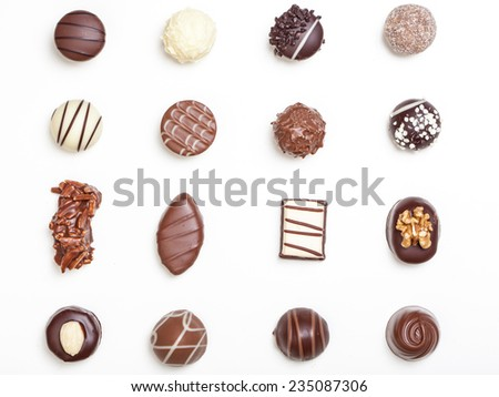 Variety of chocolate truffles, pralines, isolated on white background. - stock photo