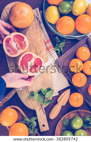 Variety of citrus fruit including lemons, limes, grapefruits and oranges. - stock photo