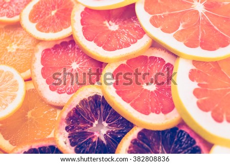 Variety of citrus fruit including lemons, lines, grapefruits and oranges.