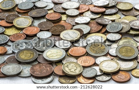 Variety of coins from around the world - closeup background - stock photo