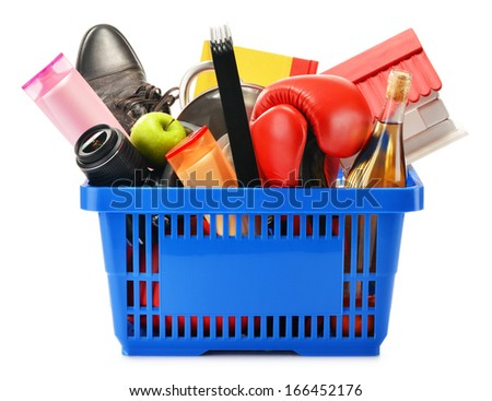 Variety of consumer products in plastic shopping basket isolated on white