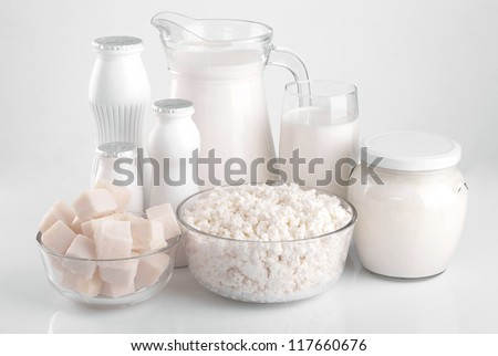 Variety of dairy products such as cheese, milk, yogurt, sour cream. - stock photo