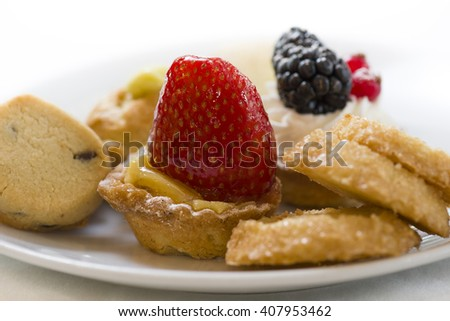 variety of decorated sweet pastry on plate - stock photo