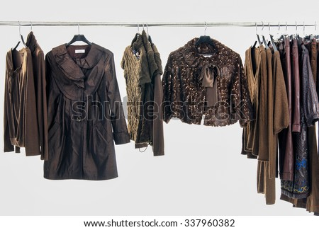 Variety of different clothes for females rack display - stock photo