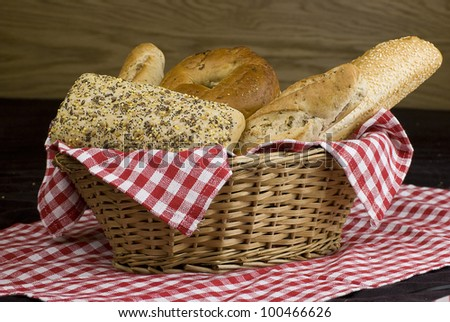 variety of different freshly baked bread in baskets - stock photo