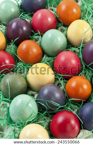 Variety of Easter eggs in egg carton, elevated view - stock photo