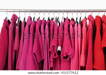 Variety of female red clothing on hanging - stock photo