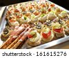 Variety of finger food on catering event. Shallow focus - stock