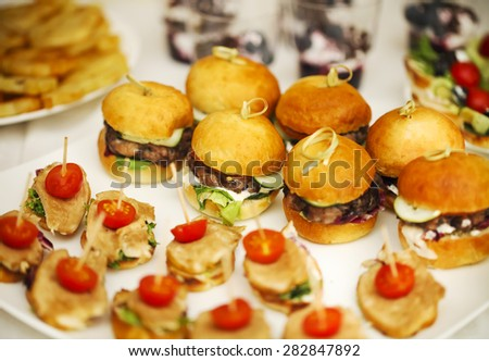 Variety of finger food on catering event. Shallow focus - stock photo