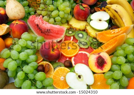 variety of fresh fruit with water drops on them