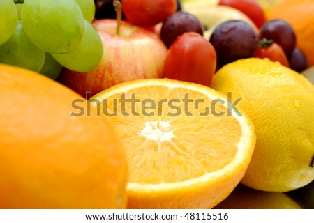 Variety of fresh natural fruits.  Wholesome food. - stock photo