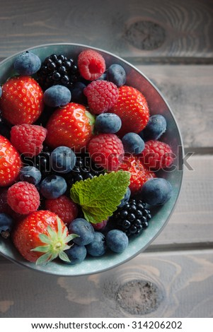 Variety of fresh summer berries. Strawberry, raspberries, blueberries, top view - stock photo