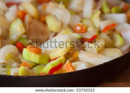 Variety of fried vegetables in a pan - stock photo