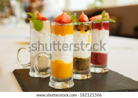 variety of fruit puree with whipped cream - stock photo