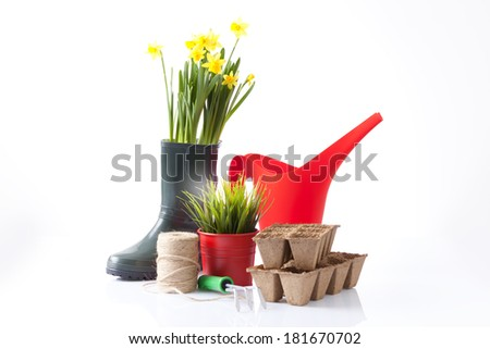 variety of garden tools including watering can and boots - stock photo