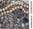 variety of golden and silver jewels background - stock photo