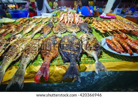 Variety of grilled seafood in Kota Kinabalu night market in Kota Kinabalu, Sabah Borneo, Malaysia. Selective focus, shallow DOF - stock photo