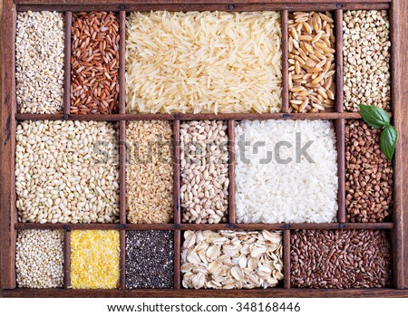 Variety of healthy grains and seeds in a wooden box - stock photo