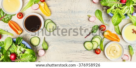 Variety of healthy salad  and dressing ingredients on light rustic background, top view, banner. Healthy  lifestyle or detox diet food  concept - stock photo