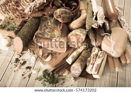 Variety of meats, sausages and mince with herbs on table