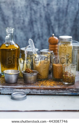 Variety of mustard glass jars.