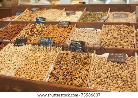 Variety of nuts on street market, limited focus - stock photo