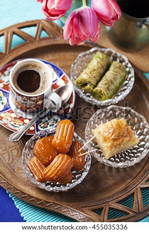 Variety of oriental sweets with cup of coffee