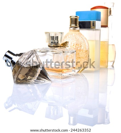 Variety of perfume bottles over background