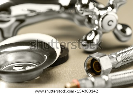 Variety of plumbing accessories - stock photo