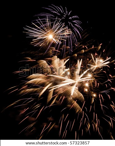 Variety of pyrotechnic effects during one moment of a fireworks display