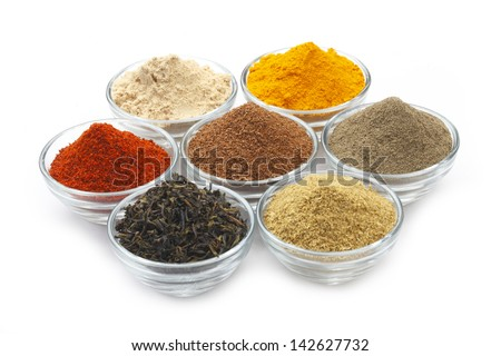 Variety of raw Authentic Indian Spice Powder on bowl. Focus on Cinnamon Powder in full-frame. - stock photo
