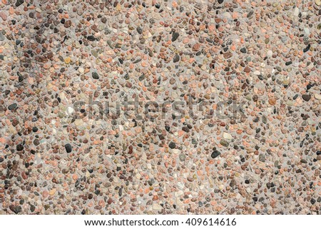 Variety of river pebbles wall. Texture with A lot of small round stones. Light Coloured Pattern of pebbles. Abstract Background Texture of many color, rose, brown, white and black stones. Filled frame - stock photo