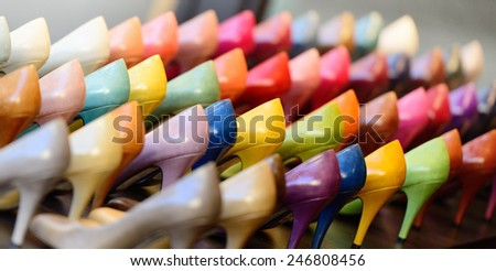 Variety of shoes in shop window display - stock photo