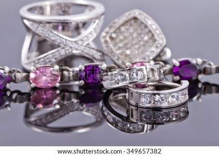 variety of silver jewelry : rings, earrings and pendant - stock photo