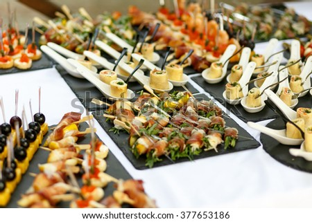 Variety of tasty delicious snacks on the rich wedding table - stock photo