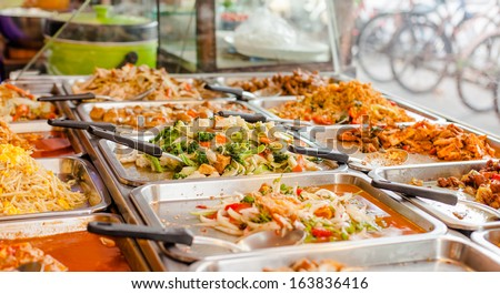 variety of thai food in Thai style fast-food on roadside - stock photo