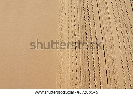 Variety of tire tracks in sand