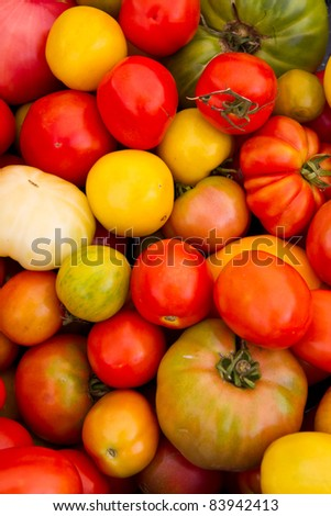 Variety of tomatoes at a local farmer's market - stock photo