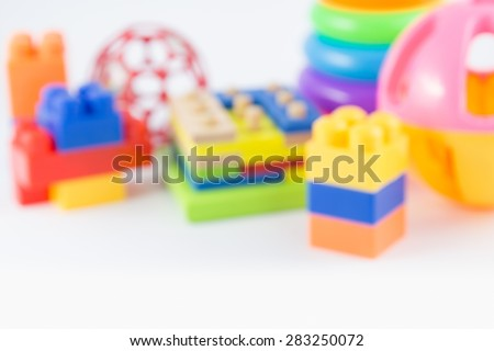 variety of toys, blured on white background