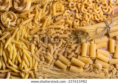 Variety of types and shapes of dry pasta - stock photo